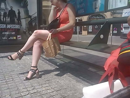 Dame with chubby sexy legs on bus stop