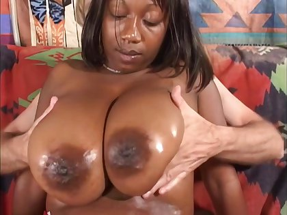 Ebony BBW mature gets cum on tits in interracial homemade sham - giant black boobs